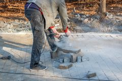 A worker prepares a sidewalk for paving a footpath. stock photo