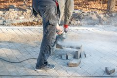 A worker prepares a sidewalk for paving a footpath. stock photos
