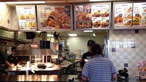 Worker preparing food for customer stock video footage