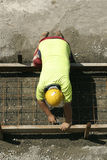 Worker preparing for a footpath sidewalk Royalty Free Stock Image