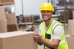 Worker preparing goods for dispatch Stock Image