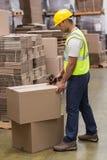 Worker preparing goods for dispatch. Worker in warehouse preparing goods for dispatch stock images