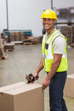 Worker preparing goods for dispatch. Worker in warehouse preparing goods for dispatch royalty free stock image