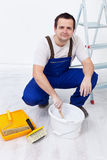 Worker preparing the paint. And utensils to repaint a room Stock Photos