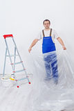 Worker preparing the room to repaint Stock Images