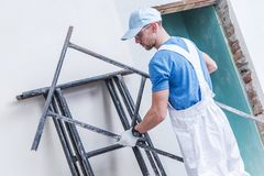 Worker Preparing Scaffolding stock photography
