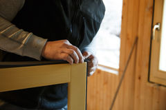 Worker preparing to install new three pane wooden windows Royalty Free Stock Photos