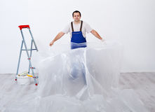 Worker preparing to paint a room Stock Image