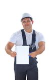 Worker presenting empty board Royalty Free Stock Photos
