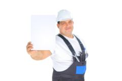 Worker presenting empty board. Confident worker presenting empty board Royalty Free Stock Image