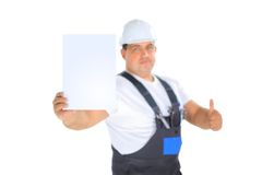 Worker presenting empty board and making ok sing. Confident worker presenting empty board and making ok sing Stock Image