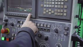 The worker presses the buttons of the old control panel with the display. Close-up of the hand of a man working pressing the buttons of the old control panel stock video
