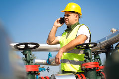 Worker produce oil Royalty Free Stock Photos