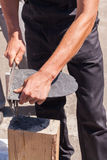 Worker produces roofing slate using a slate hammer. Worker produces roofing slate using a slate hammer Stock Photos