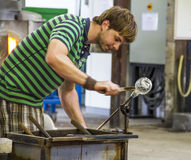 Worker producing a piece of glass Royalty Free Stock Image