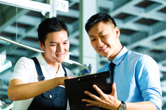 Worker and production manager with Clipboard Royalty Free Stock Image