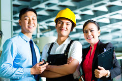 Worker, Production manager and owner in factory Royalty Free Stock Photo