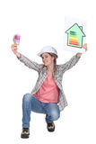 Worker promoting energy savings. Stock Image