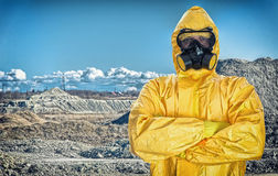 Worker in protective chemical suit. Over mountains Stock Image
