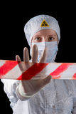 Worker in protective clothing showing hand gesture STOP danger. Zone royalty free stock photography