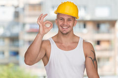 Worker With Protective Gear Showing Ok Sign Royalty Free Stock Images