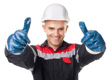 Worker in protective gloves giving thumb up Royalty Free Stock Photos
