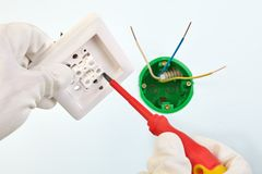 Tightening screw in two-button light switch stock photography