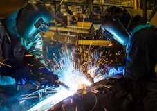 Worker with protective mask welding Stock Images