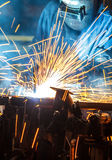 Worker with protective mask welding metal. Industrial  car Stock Images
