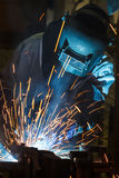 Worker with protective mask welding metal. On industry Royalty Free Stock Images