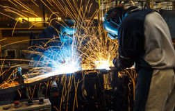 Worker with protective mask welding metal. Team worker with protective mask welding Royalty Free Stock Photography