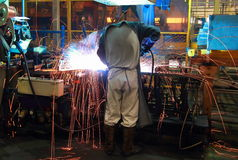 Worker with protective mask welding metal. The team work Stock Photography