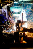Worker with protective mask welding metal. Welder with protective mask welding metal and sparks Stock Image