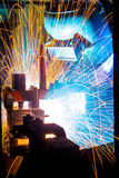 Worker with protective mask welding metal. Welder with protective mask welding metal and sparks Royalty Free Stock Photography