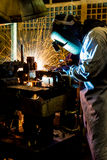 Worker with protective mask welding metal. Welder with protective mask welding metal and sparks Stock Images