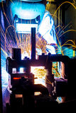 Worker with protective mask welding metal. Welder with protective mask welding metal and sparks Stock Photo
