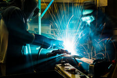 Worker with protective mask welding metal. Welder with protective mask welding metal and sparks Royalty Free Stock Image