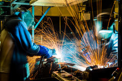 Worker with protective mask welding metal. Welder with protective mask welding metal and sparks Stock Photography