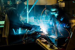 Worker with protective mask welding metal. Welder with protective mask welding metal and sparks Royalty Free Stock Photos