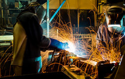 Worker with protective mask welding metal. Welder with protective mask welding metal and sparks Royalty Free Stock Images