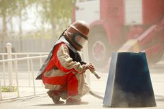 Worker in a protective suit spraying sand Royalty Free Stock Photography