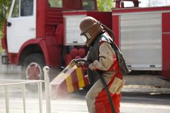 Worker in a protective suit spraying sand Stock Photography