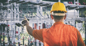 Worker with protective uniform in front of power plant Stock Photos