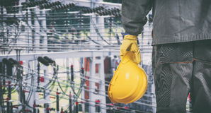 Worker with protective uniform in front of power plant Royalty Free Stock Photography