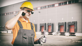 Worker with protective uniform in front of shipping warehouse ga Royalty Free Stock Photography