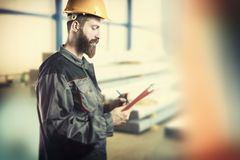 Worker in protective uniform and protective helmet Royalty Free Stock Photo