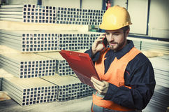 Worker in protective uniform and protective helmet Stock Image