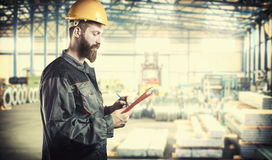 Worker in protective uniform and protective helmet Royalty Free Stock Images