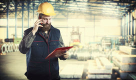 Worker in protective uniform and protective helmet Stock Photos