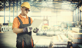 Worker in protective uniform and protective helmet Royalty Free Stock Image